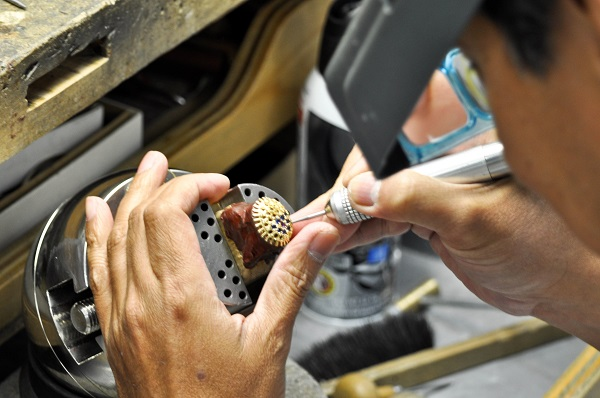 Our in-store  craftsman setting the stones.